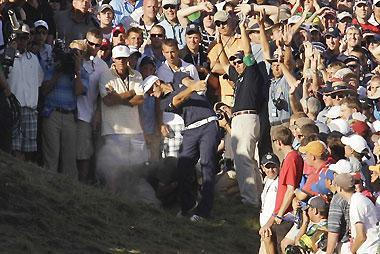 Dustin Johnson hits from the crowd on the 18th hole during the final round