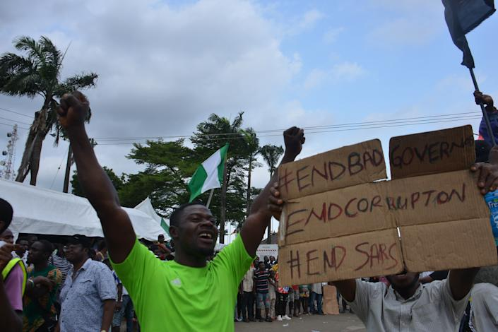 Protesters march at Alausa Secretariat in Ikeja, Lagos State, during a peaceful demonstration against police brutality in Nigeria, on October 20, 2020. (Photo by Olukayode Jaiyeola/NurPhoto via Getty Images)