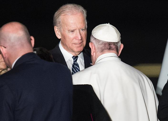 US Vice President Joe Biden bids farewell to Pope Francis before he boards his plane in Philadelphia on September 27, 2015 at the end of his six-day visit to the US.