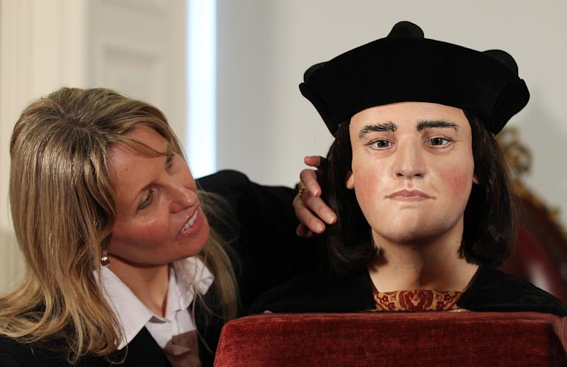 Philippa Langley, originator of the 'Looking for Richard III' project, looks at the facial reconstruction of Richard III, unveiled to the media at the Society of Antiquaries, London, Tuesday Feb. 5, 2013. He was king of England, but for centuries he lay without shroud or coffin in an unknown grave, and his name became a byword for villainy. On Monday, scientists announced they had rescued the remains of Richard III from anonymity — and the monarch's fans hope a revival of his reputation will soon follow. (AP Photo/PA, Gareth Fuller) UNITED KINGDOM OUT  NO SALES  NO ARCHIVE