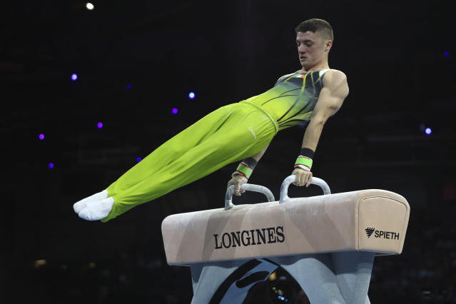 Bronze medalist Rhys McClenaghan of Ireland performs on the pommel horse in the men's apparatus finals at the Gymnastics World Championships in Stuttgart, Germany, Saturday, Oct. 12, 2019. (AP Photo/Matthias Schrader)