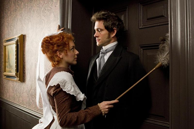 """In this film image released by Sony Pictures Classics, Sheridan Smith portrays Molly, left, and Hugh Dancy portrays Mortimer Granville in a scene from """"Hysteria."""" (AP Photo/Sony Pictures Classics, Liam Daniel)"""
