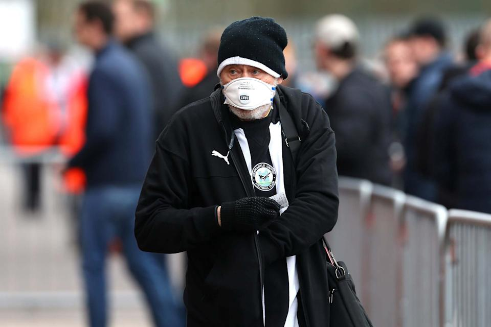 A Newcastle United fan with a face mask before the Premier League match at St Mary's Stadium, Southampton: PA
