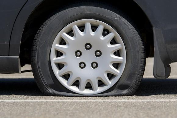 A flat tire on a car