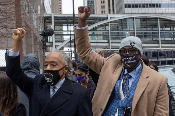 PHOTO: Philonise Floyd raises his fist as he arrives with Reverend Al Sharpton to the Hennepin County Government Center for closing arguments in the murder trial of former police officer Derek Chauvin in Minneapolis, Minnesota, April 19, 2021. (Adrees Latif/Reuters)