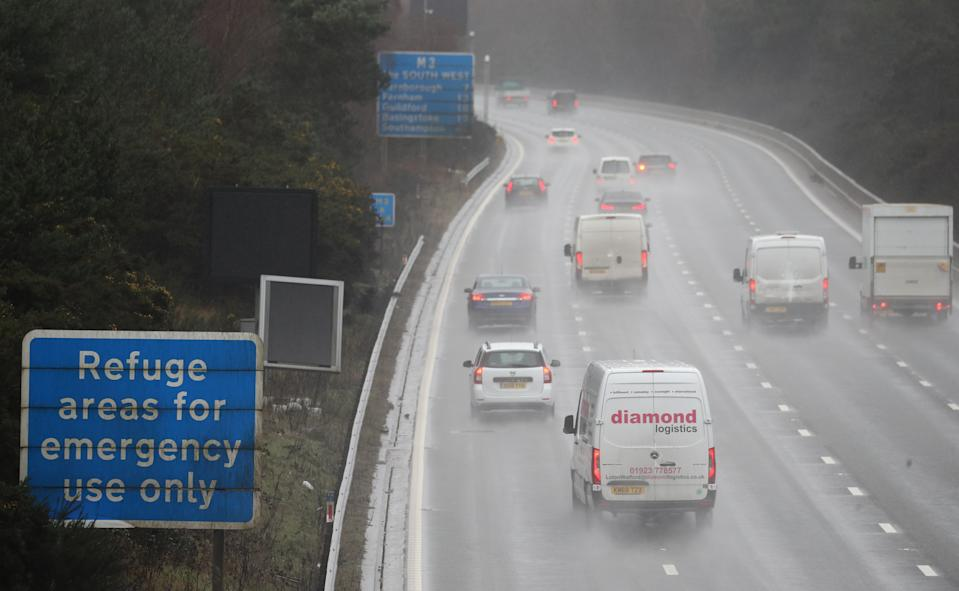 Vehicles make their way past a sign saying 'Refuge areas for emergency use only' on the southbound carriageway near Bagshot in Surrey where the M3 has been converted into a smart motorway with the hard shoulder rebuilt as an additional lane. Picture date: Wednesday January 20, 2021.