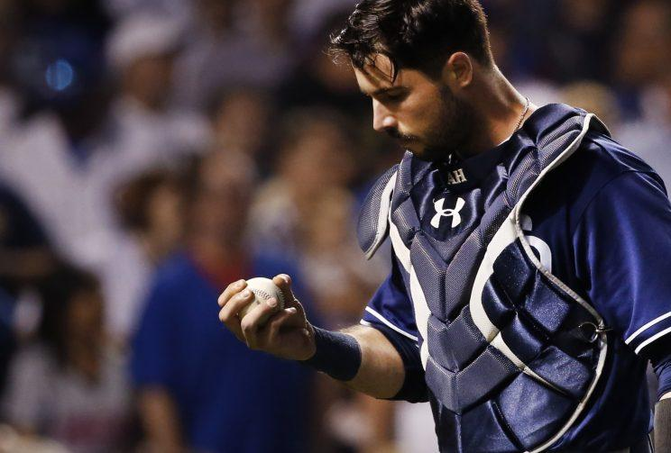 Austin Hedges left Monday's game following a collision with Anthony Rizzo. (AP Photo)