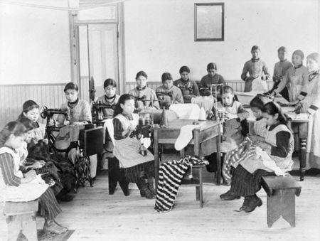 A group of students take part in sewing class at St Joseph's Convent, otherwise known as the Fort Resolution Indian Residential School in Fort Resolution, Northwest Territories in an undated archive photo. REUTERS/Canada. Dept. of Mines and Technical Surveys/Library and Archives Canada/PA-023095/handout via Reuters