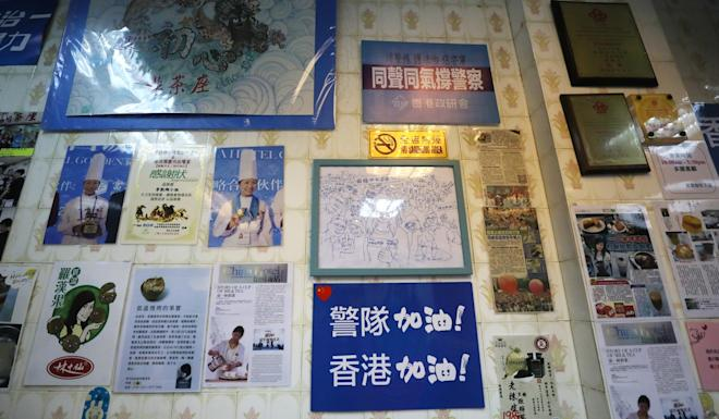 Messages of support for police adorn a wall at Ngan Loong Cafe. Photo: Xiaomei Chen