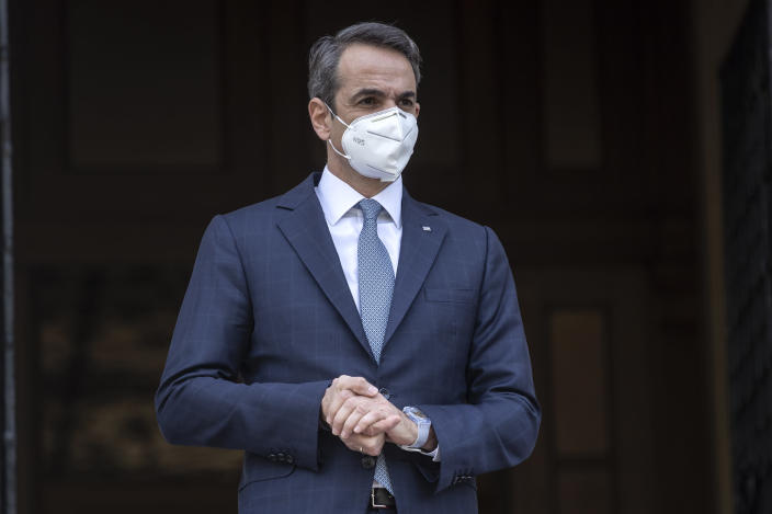 Greek Prime Minister Kyriakos Mitsotakis looks on as he waits for the arrival of the head of the Presidential Council of Libya Mohamed al-Menfi prior their meeting, in Athens, on Wednesday, April 14, 2021.(AP Photo/Petros Giannakouris)