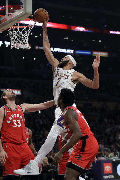 Los Angeles Lakers' JaVale McGee (7) dunks over Toronto Raptors' Marc Gasol (33) during the first half of an NBA basketball game Sunday, Nov. 10, 2019, in Los Angeles. (AP Photo/Marcio Jose Sanchez)