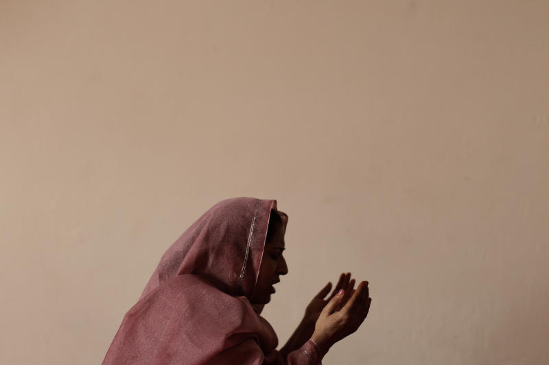 A Pakistani Christian woman prays during a Mass on Good Friday in a church in Islamabad, Pakistan, Friday, April 6, 2012. Christians around the world are marking the Easter holy week. (AP Photo/Muhammed Muheisen)