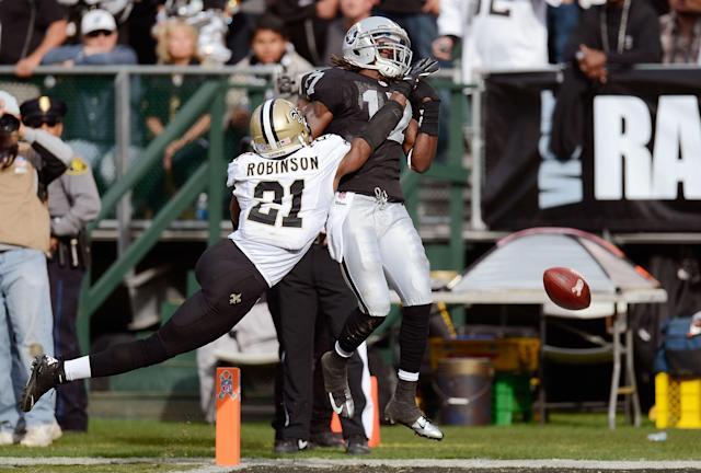 OAKLAND, CA - NOVEMBER 18: Patrick Robinson #21 of the New Orleans Saints gets called for pass interference in the endzone on Denarius Moore #17 of the Oakland Raiders during the second quarter of their NFL football game at O.co Coliseum on November 18, 2012 in Oakland, California. (Photo by Thearon W. Henderson/Getty Images)