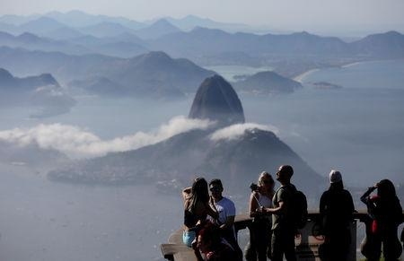 FILE PHOTO: Tourists are seen with the Sugarloaf Mountain in the background in Rio de Janeiro