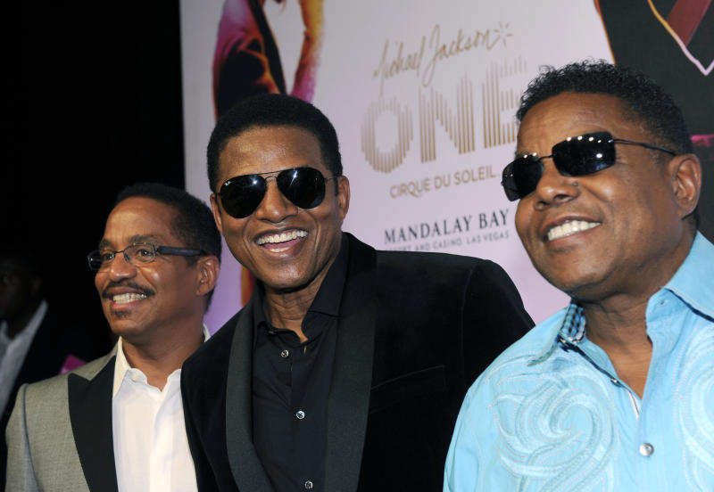 "The Jacksons, from left, Marlon Jackson, Tito Jackson and Jackie Jackson arrive at the world premiere of ""Michael Jackson ONE"" at THEhotel at Mandalay Bay Resort and Casino on Saturday, June 29, 2013 in Las Vegas. (Photo by David Becker/Invision/AP)"