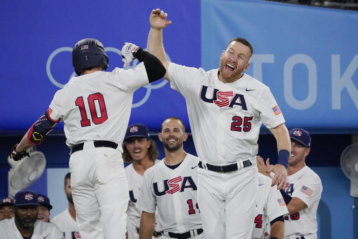 United States' Nick Allen celebrates with Todd Frazier after hitting a home run in the fifth inning of a baseball game against South Korea at the 2020 Summer Olympics, Saturday, July 31, 2021, in Yokohama, Japan. (AP Photo/Sue Ogrocki)