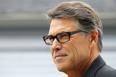 """Texas Governor Rick Perry, a possible Republican candidate for the 2016 presidential race waits to speak at a """"NH GOP Victory Rally"""" in Stratham"""