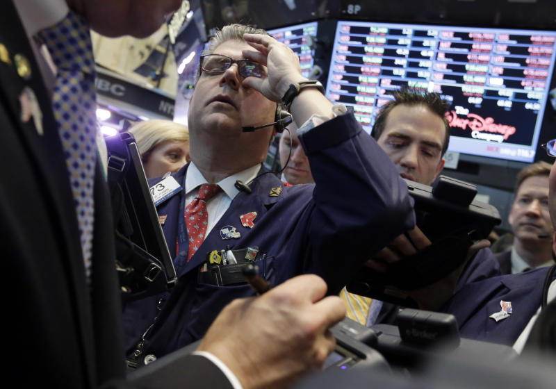 Stocks edge lower as investors reassess Fed fears
