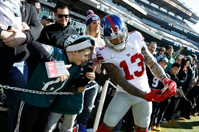 Former New York Giants wide receiver Odell Beckham poses for a photograph with fans before a game against the Eagles last season. (AP)