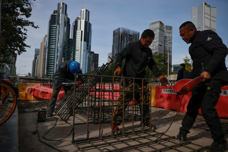 Workers weld iron grids at a construction site in the Central Business District (CBD) following an outbreak of the coronavirus disease (COVID-19) in Beijing