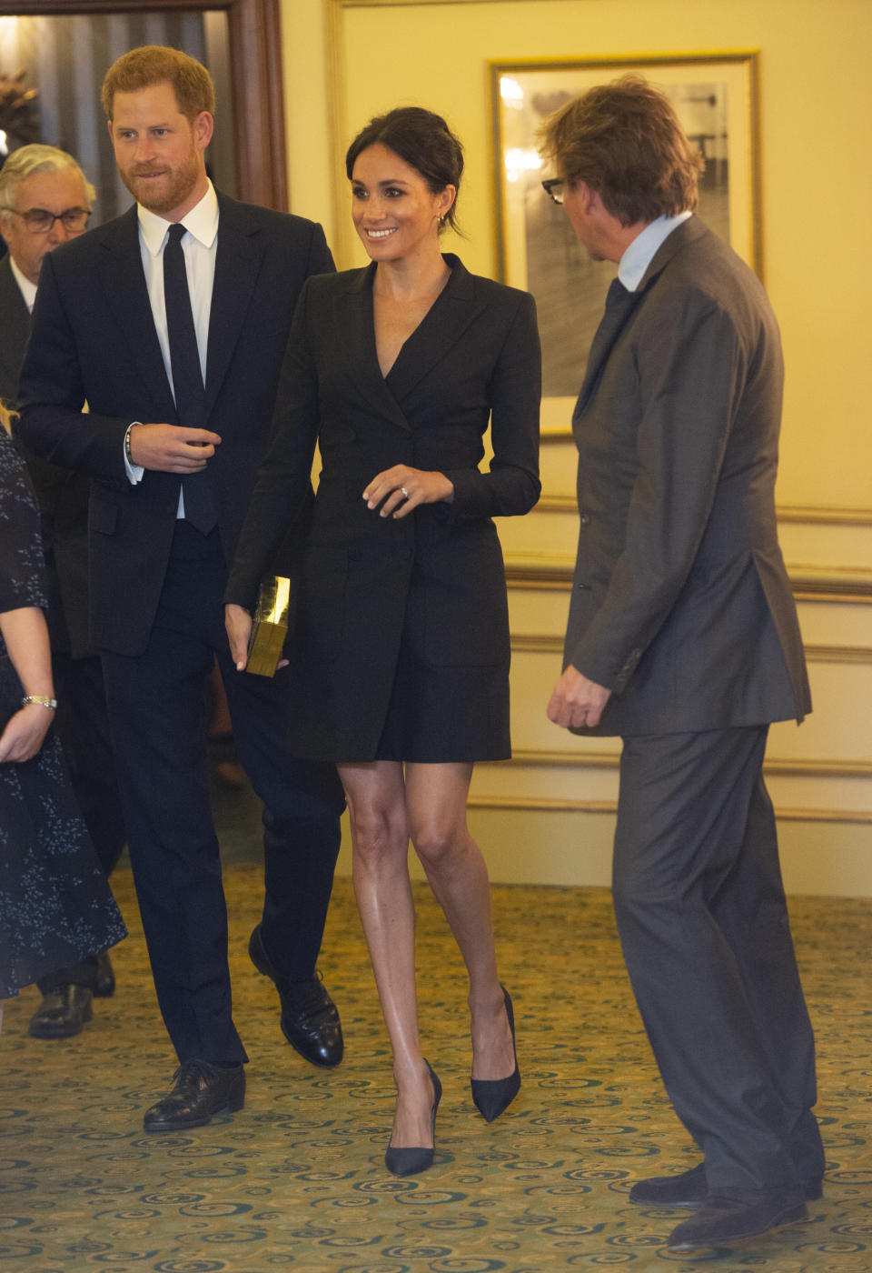 <p>On April 29, the Duke and Duchess broke a nearly month-long hiatus from the public eye attending a gala performance of 'Hamilton'. For the occassion, Meghan threw caution to the royal rulebook by wearing a tuxedo mini dress from Canadian label Judith & Charles. The dress diced with protocol, coming to roughly five inches above the knee. She paired the glamorous evening look with Paul Andrews heels, a £49 Becksondergaard clutch and stunning drop earrings by Shaun Leane. <em>[Photo: Getty]</em> </p>