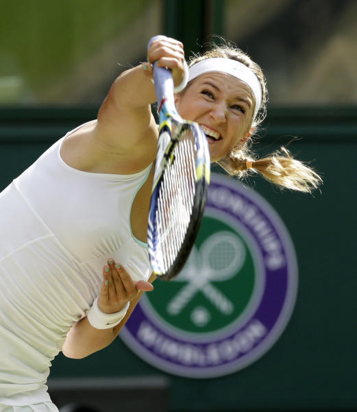 Victoria Azarenka of Belarus serves to Serena Williams of the United States during a semifinals match at the All England Lawn Tennis Championships at Wimbledon, England, Thursday, July 5, 2012. (AP Photo/Anja Niedringhaus)