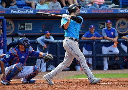 FILE PHOTO: Mar 8, 2019; Port St. Lucie, FL, USA; Miami Marlins infielder Neil Walker (18) connects for a three run home against the New York Mets during a spring training game at First Data Field. Mandatory Credit: Steve Mitchell-USA TODAY Sports