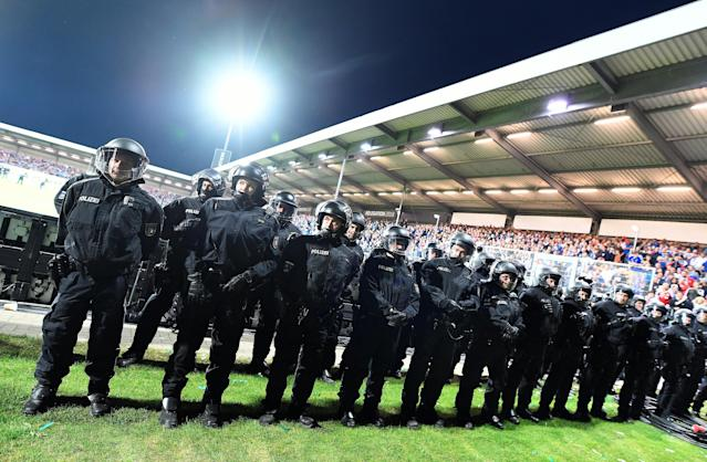 Soccer Football - Bundesliga Promotion/Relegation Playoff Second Leg - Holstein Kiel vs VfL Wolfsburg - Holstein-Stadion, Kiel, Germany - May 21, 2018 Police after the match REUTERS/Fabian Bimmer DFL RULES TO LIMIT THE ONLINE USAGE DURING MATCH TIME TO 15 PICTURES PER GAME. IMAGE SEQUENCES TO SIMULATE VIDEO IS NOT ALLOWED AT ANY TIME. FOR FURTHER QUERIES PLEASE CONTACT DFL DIRECTLY AT + 49 69 650050