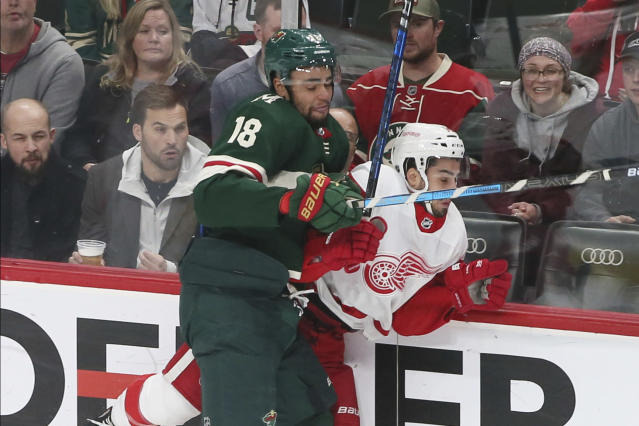 Minnesota Wild's Jordan Greenway, left, checks Detroit Red Wings' Robby Fabbri in the first period of an NHL hockey game Wednesday, Jan. 22, 2020, in St. Paul, Minn. (AP Photo/Jim Mone)