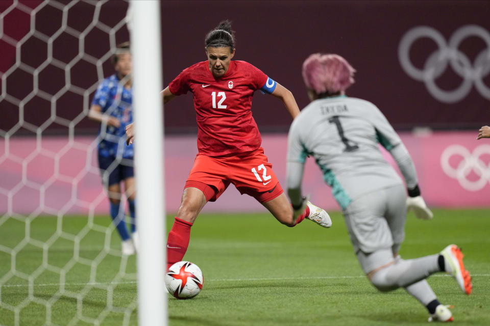 Canada's Christine Sinclair (12) scores a goal against Japan at the 2020 Summer Olympics, Wednesday, July 21, 2021, in Sapporo, Japan. (AP Photo/Silvia Izquierdo)
