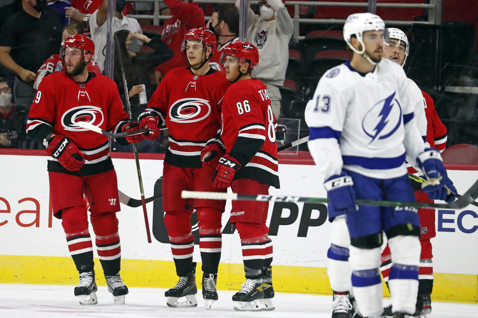 The Caroline Hurricanes celebrate a goal by Jesperi Kotkaniemi (82), during the first period of an NHL pre season hockey game against the Tampa Bay Lightning in Raleigh, N.C., Tuesday, Sept. 28, 2021. (AP Photo/Karl B DeBlaker)