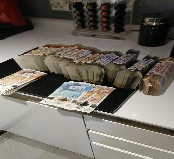 A picture of cash in Catherine Roche's kitchen that was found on her encrypted phone