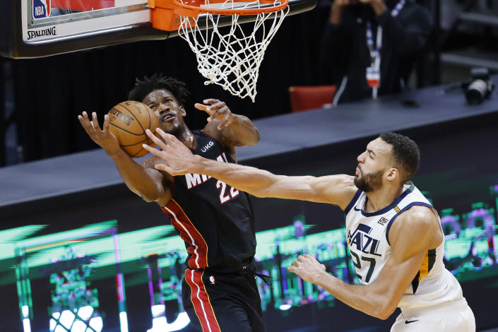 Rudy Gobert #27 of the Utah Jazz blocks a shot by Jimmy Butler #22 of the Miami Heat during the fourth quarter at American Airlines Arena on February 26, 2021 in Miami, Florida. NOTE TO USER: User expressly acknowledges and agrees that, by downloading and or using this photograph, User is consenting to the terms and conditions of the Getty Images License Agreement.  (Photo by Michael Reaves/Getty Images)