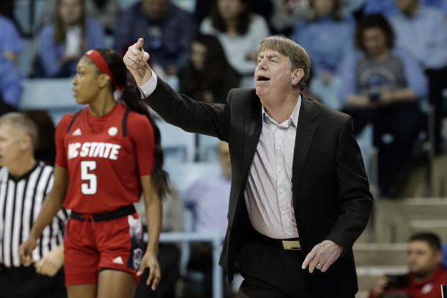 North Carolina State, right, head coach Wes Moore directs his players during the first half of an NCAA college basketball game against North Carolina in Chapel Hill, N.C., Thursday, Jan. 9, 2020. (AP Photo/Gerry Broome)