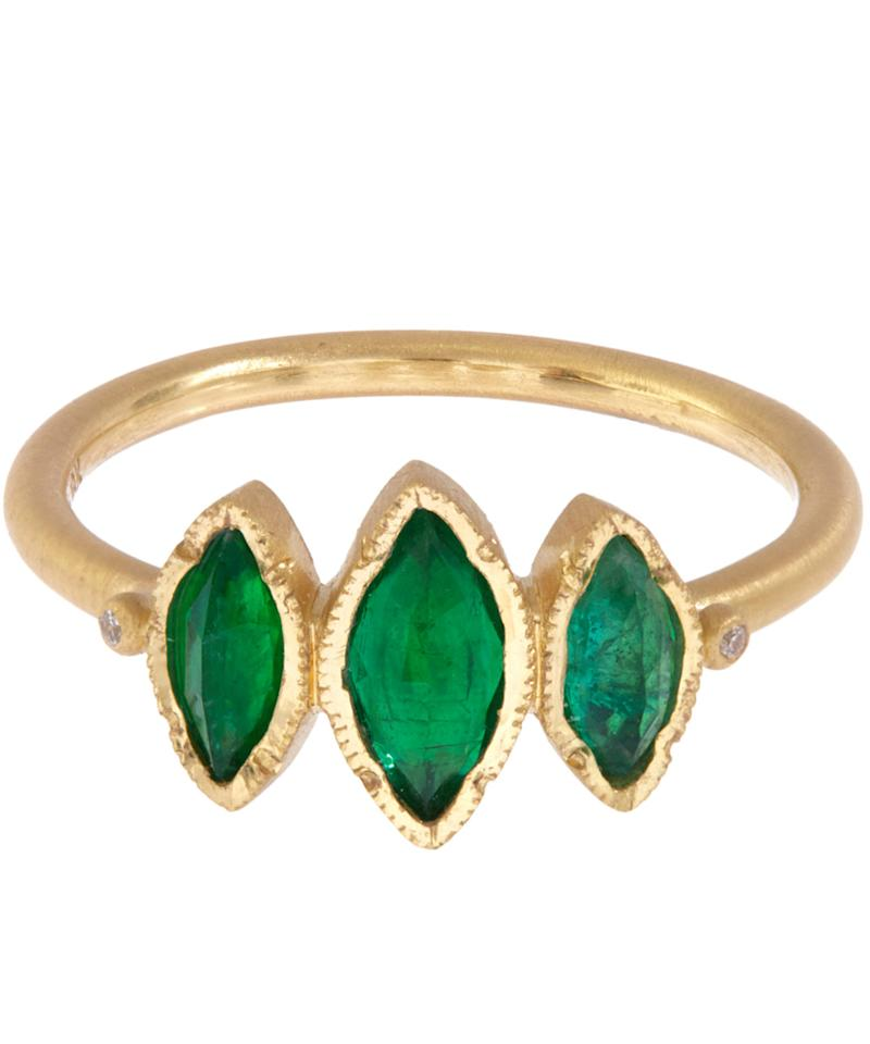 """<p><i><a href=""""http://www.liberty.co.uk/fcp/product/Liberty//Gold-Triple-Marquise-Emerald-Ring/146302"""">Liberty, £1,990</a></i></p>"""