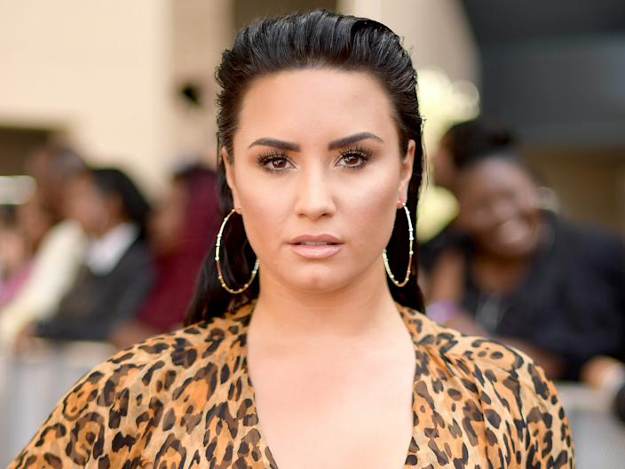 Demi Lovato recalled her previous team watching her prior to photo shoots to monitor what she ate.