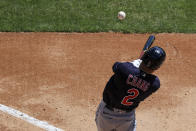 Cleveland Indians' Yu Chang hits the ball for a single during the third inning of a baseball game against the Cincinnati Reds in Cincinnati, Sunday, April 18, 2021. (AP Photo/Aaron Doster)