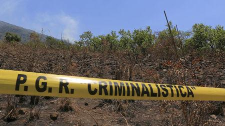 The crash site of a military helicopter is cordoned off with police tape near Villa Purificacion, Mexico, May 5, 2015. REUTERS/Stringer/File Photo