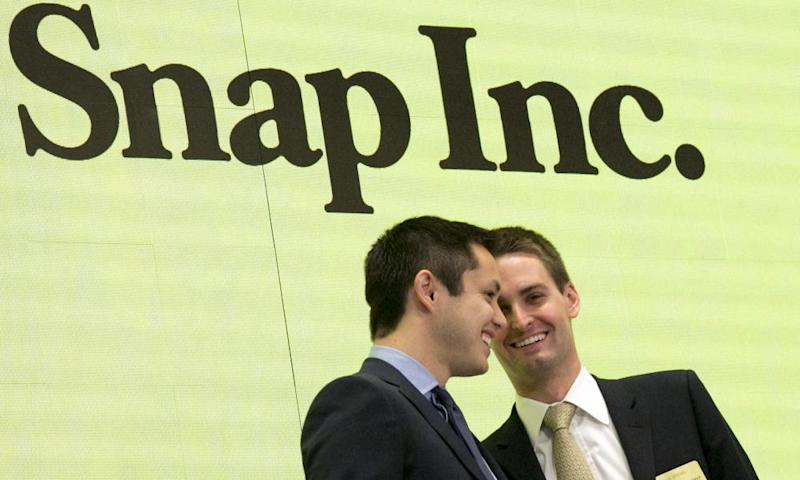 Snapchat co-founders Bobby Murphy, left, and chief executive Evan Spiegel ring the opening bell at the New York Stock Exchange as the company celebrates its flotation.