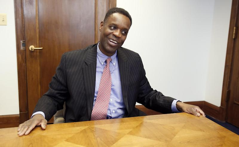 Kevyn Orr, Detroit emergency financial manager, smiles while answering a reporters question during an interviewed on Wednesday, March 20, 2013, in Detroit. The newly appointed emergency manager charged with getting Detroit's finances back on track is welcoming input from city officials as he begins his job next week. (AP Photo/Duane Burleson)