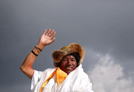 FILE PHOTO: Kami Rita Sherpa, 48, a Nepali mountaineer waves towards the media personnel upon his arrival after climbing Mount Everest for a 22nd time, creating a new record for the most summits of the worldÕs highest mountain, in Kathmandu, Nepal May 20, 2018. REUTERS/Navesh Chitrakar/File Photo