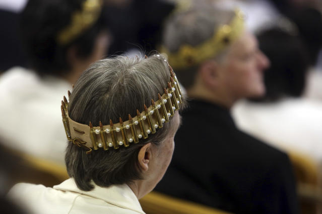 <p>A woman wears a crown made of ammunition during services at the World Peace and Unification Sanctuary, Wednesday Feb. 28, 2018 in Newfoundland, Pa. (Photo: Jacqueline Larma/AP) </p>