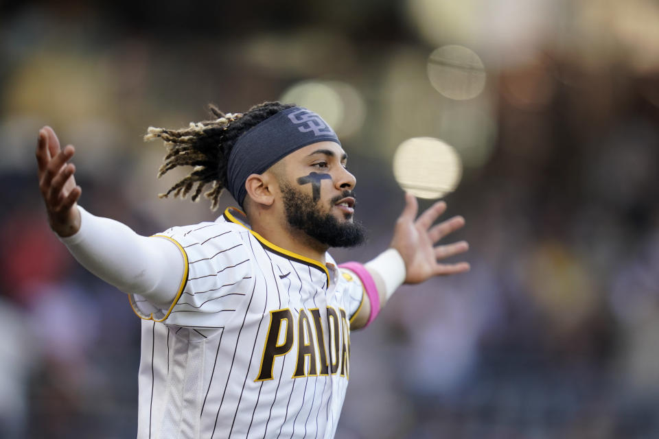 San Diego Padres' Fernando Tatis Jr. celebrates after the Padres defeated the San Francisco Giants in a baseball game Thursday, Sept. 23, 2021, in San Diego. (AP Photo/Gregory Bull)