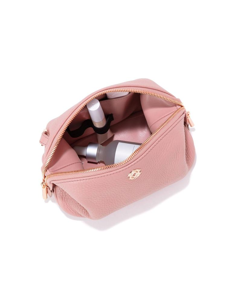 "<p>The beauty obsessive will appreciate a sleek way to keep her collection organized. Plus, this case can absolutely double as a clutch, making it a two-in-one gift. Score.</p> <p>Dagne Dover Lola Pouch</p> $75, Dagne Dover. <a href=""https://www.dagnedover.com/collections/the-lola-pouch#Wildflower-Small"">Get it now!</a>"