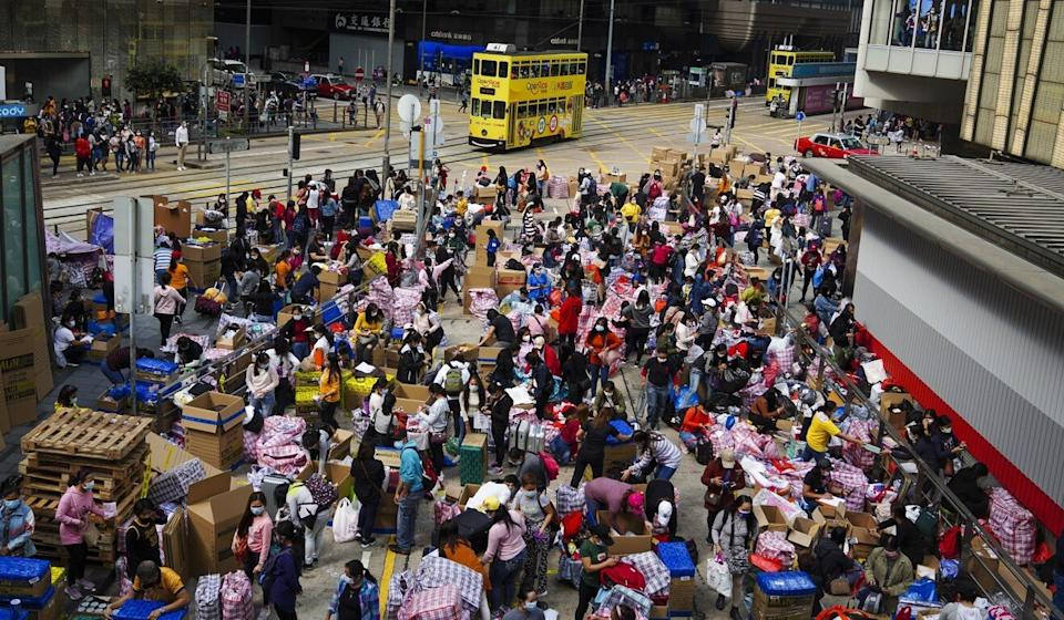 Domestic helpers at a street market in Central on their off day. Photo: Sam Tsang