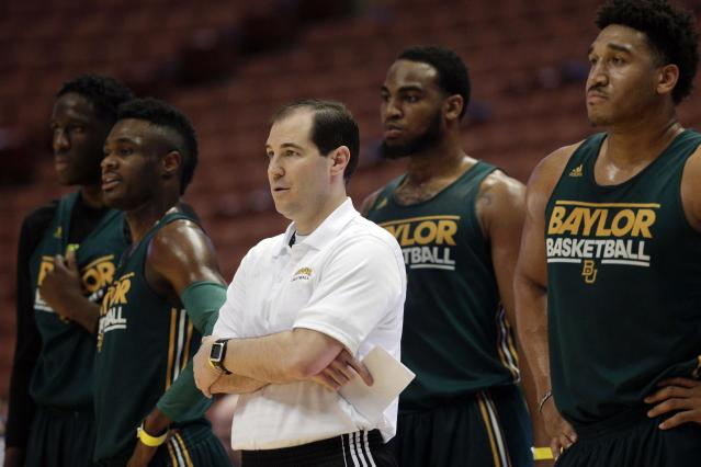 Baylor head coach Scott Drew, center, stands with Ish Wainright, from right, Rico Gathers, Gary Franklin and Taurean Prince during practice at the NCAA college basketball tournament on Wednesday, March 26, 2014, in Anaheim, Calif. Baylor plays Wisconsin in a regional semifinal on Thursday. (AP Photo/Jae C. Hong)