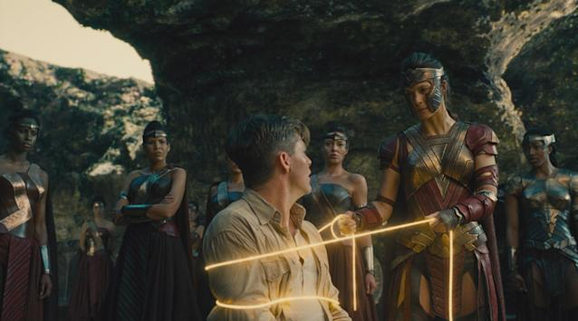 <p>Steve Trevor finds himself in a knotty situation after his plane crashes off the shore of Themyscira, bound in the Amazon's iconic golden Lasso of Truth. (Photo: Warner Bros.) </p>