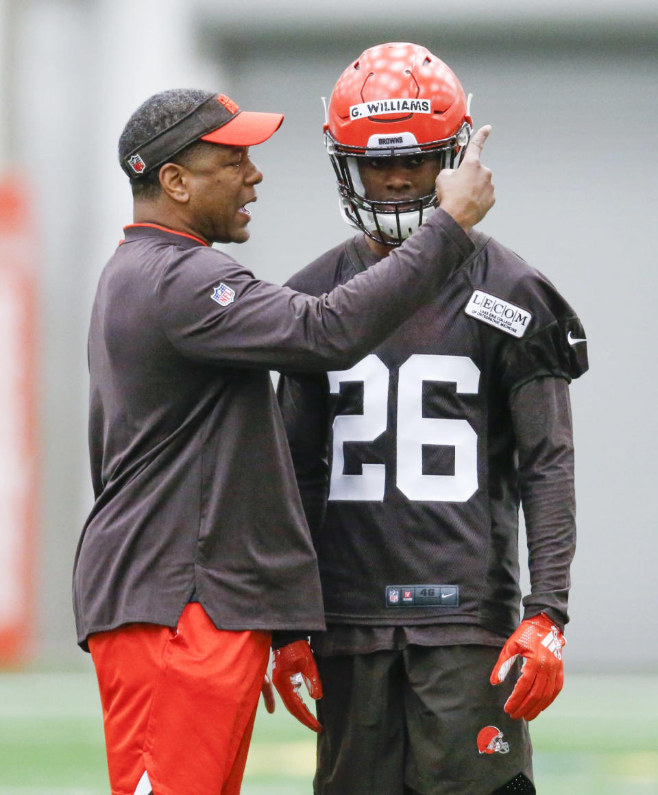 Cleveland Browns defensive coordinator Steve Wilks directs Greedy Williams during an NFL football rookie minicamp Friday, May 3, 2019, in Berea, Ohio. (AP Photo/Ron Schwane)