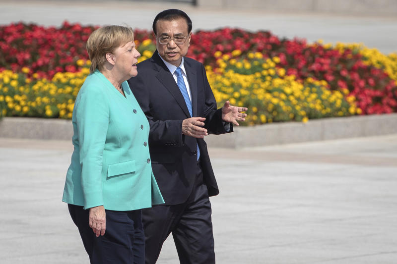 Chinese Premier Li Keqiang, right, and German Chancellor Angela Merkel attend a welcome ceremony at the Great Hall of the People in Beijing, Friday, Sept. 6, 2019. Merkel visits China from Sept. 6-7, 2019. (Roman Pilipey/Pool Photo via AP)