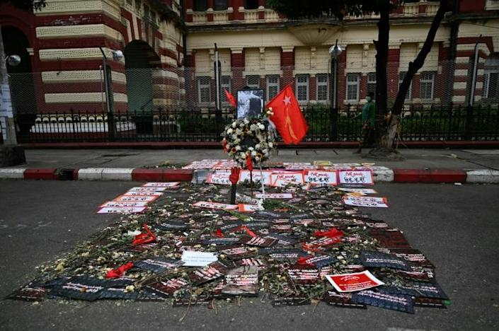 Residents in Yangon left flowers and messages outside a high court in tribute